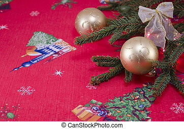 Golden Christmas spheres on a red festive cloth