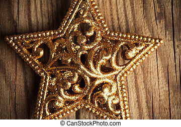 golden christmas star on wooden background