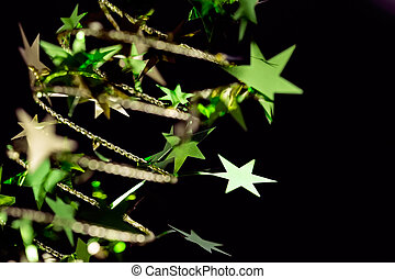 Golden Christmas stars on black background