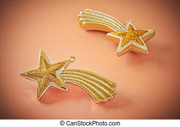 golden christmas stars on light brown background