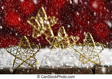 Golden Christmas stars on th red background