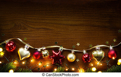 Golden Christmas Tree decoration on wooden background