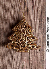 golden christmas tree on wooden background
