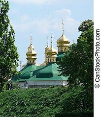 Golden Church cupolas of Kyjevo-Pecherska Lavra or Calvin Cave Monastery in Kyiv, Ukraine