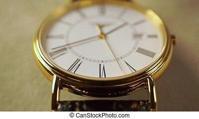 Golden classical wrist watch macro shot. Slow motion video