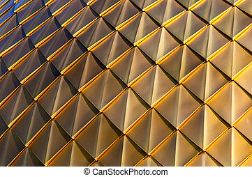 Golden coating on the roof as a background