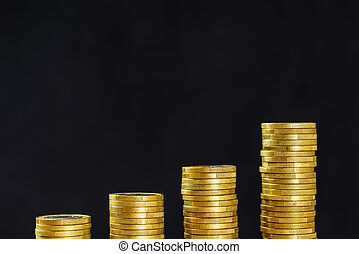 Golden coin stacks on a black background