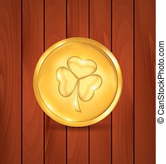 Golden coin with clover on brown wooden texture for St. Patrick's Day