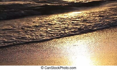 Golden colors on the waves.