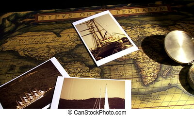 Golden compass, old maps and sailing ships photos, pan right...