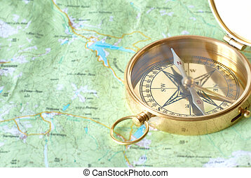 Golden compass on the map