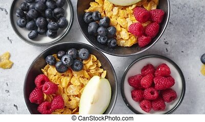 Golden cornflakes with fresh fruits of raspberries, ...