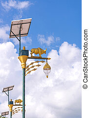 golden cow light bulb and solar energy with blue sky background