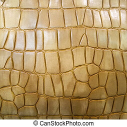 Golden crocodile leather background