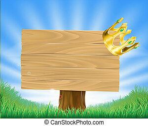 Golden crown hanging on sign