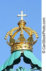 Golden crown with a Christian cross