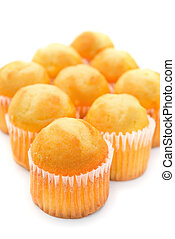 golden cup cakes on a white background