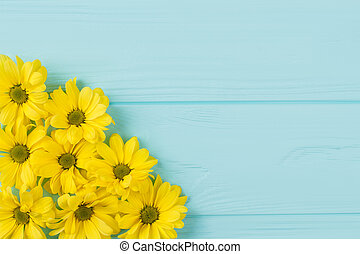 Golden-daisy collection on blue wood.