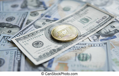 Golden Dash Cryptocurrency coin on a pile of US dollars,...