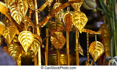 Golden decorative leaflets wave on a wind in ancient Angkor...