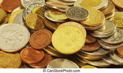 Golden different coins collection background rotating, loop...