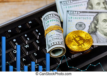 Golden dogecoin cryptocurrency coin lying on a pile of US dollar cash banknotes, Gold Bitcoin keyboard
