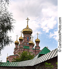 golden domes of an Orthodox church against the sky