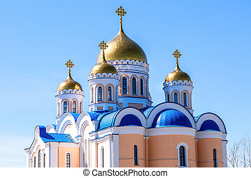 Golden domes of orthodox cathedral against the blue sky background