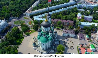 Golden domes with a cross on the Christian Orthodox Church shine on a sunny day against blue sky. Christianity and orthodox christianity concept.