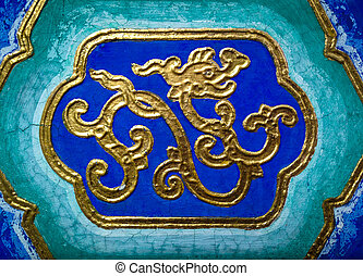Golden Dragon - Abstract golden dragon on a ceiling in a...