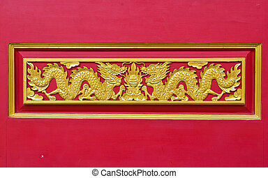 golden dragon decorated on red wood wall,chinese style in...