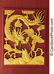 Golden dragon on the red wall