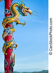 Golden dragon wrapped around red pole