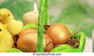 Golden easter eggs in green basket