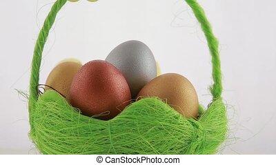 Golden Easter eggs in green basket