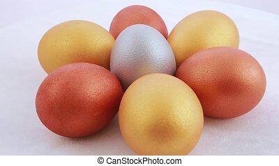 Golden easter eggs isolated over white background. Rotation.