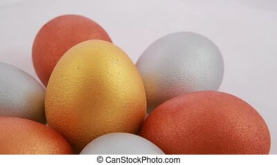 Golden easter eggs isolated over white background. Close up.
