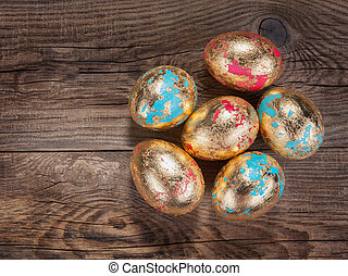 Golden Easter eggs on the old board