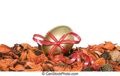 Golden egg for Easter holiday