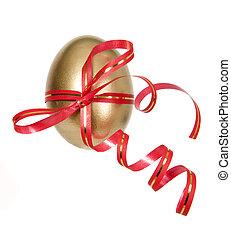 Golden egg for present