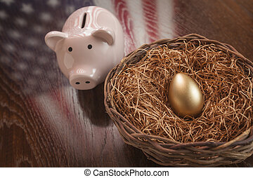 Golden Egg, Nest and Piggy Bank with American Flag Reflection