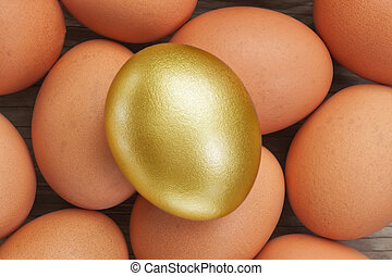 Golden egg on a background of simple. At Easter.