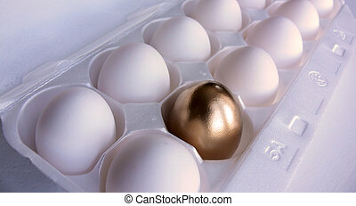 Dozen white eggs, with one of the eggs in the foreground painted a bright metallic gold. Taken with a Panasonic FZ30.