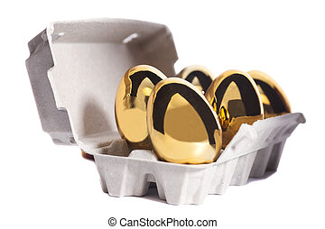 Golden eggs in box