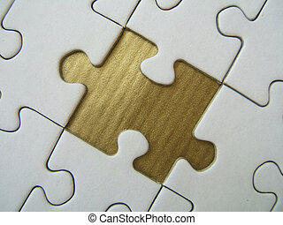 Golden element - Jigsaw close-up with a missed gold piece