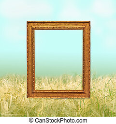 golden empty frame against a wheat field  background