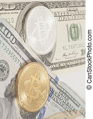 Golden end silver bitcoins with U.S. dollars close up