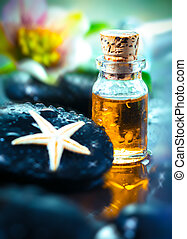 Golden essential oil and massage stone