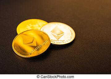 Golden ether coins or Ethereum network exchange on black ...