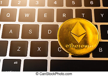 Golden ether coins or Ethereum network exchange on keyboard ...